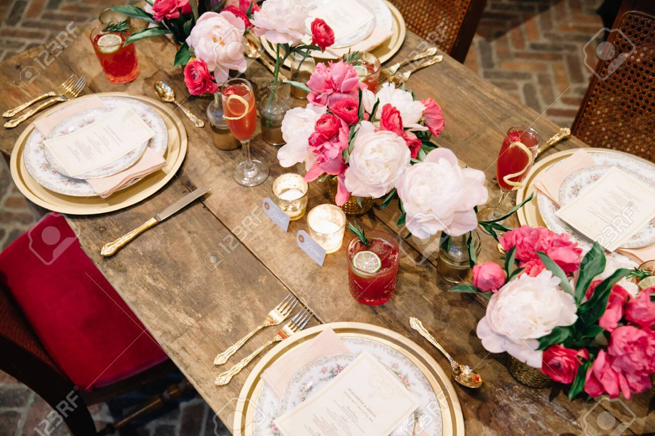 Elegant Dark Pink Wedding Banquet Table With Glasses Dishes Stock Photo Picture And Royalty Free Image Image 143925899
