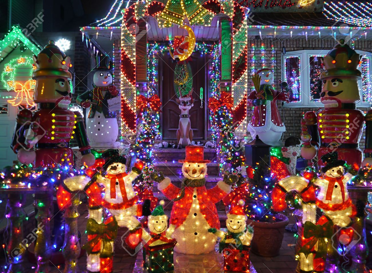 How to decorate house for christmas outdoor - Christmas Outdoor Christmas Decorations Snowman And Nutcracker Lights Up House Stock Photo 44887262