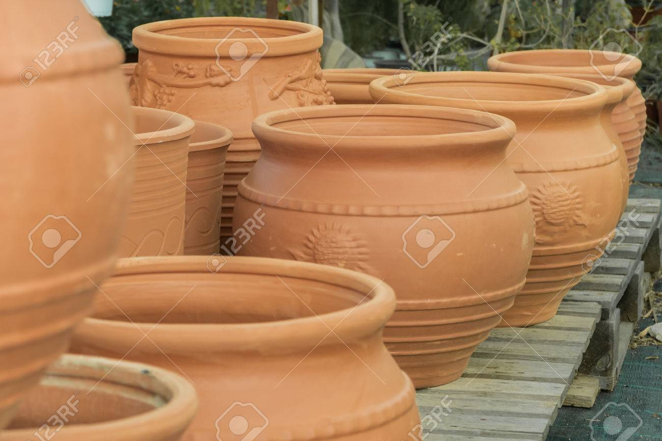 123RF.com & clay flower pots flower beds plants for decoration