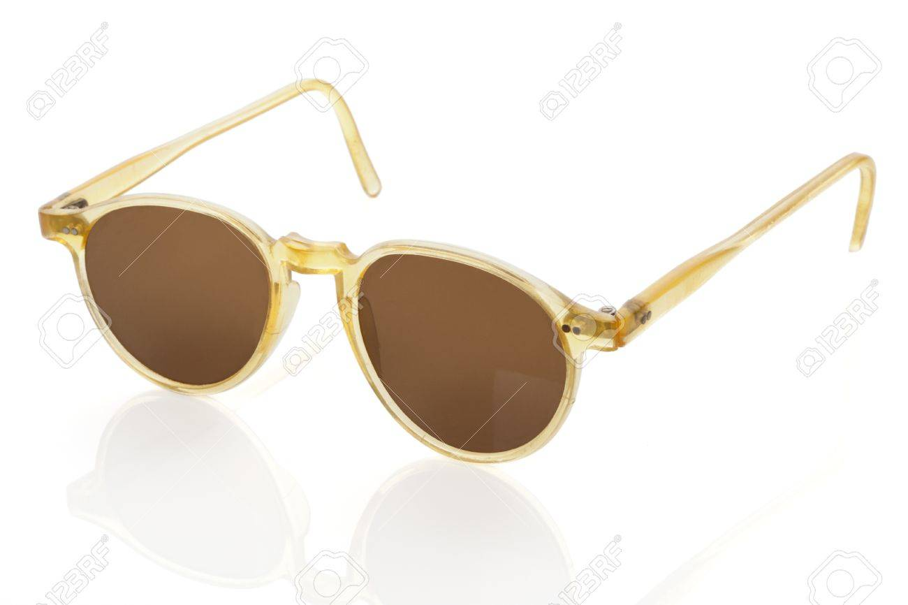 6e1e0ec916 Original vintage sunglasses in brown and yellow isolated on white  background Retro collector objects Stock Photo