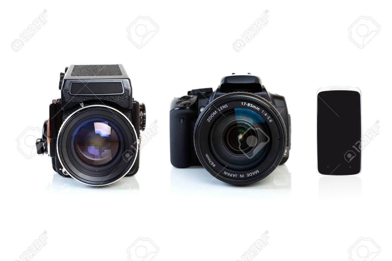 Camera Old Dslr Camera digital single lens reflex dslr camera old retro medium format and a smartphone isolated