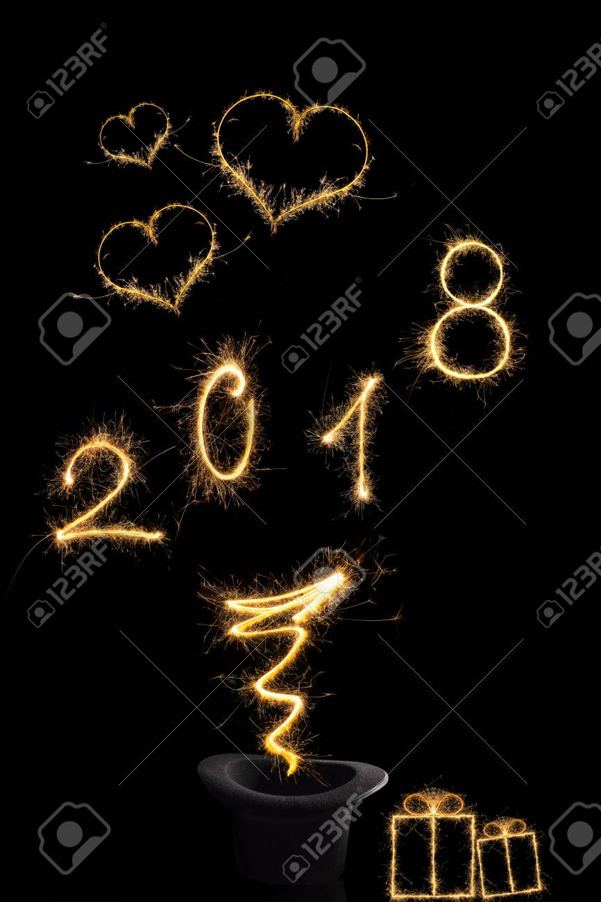 magical new year magical fireworks from black top hat forming the digits 2018 gifts