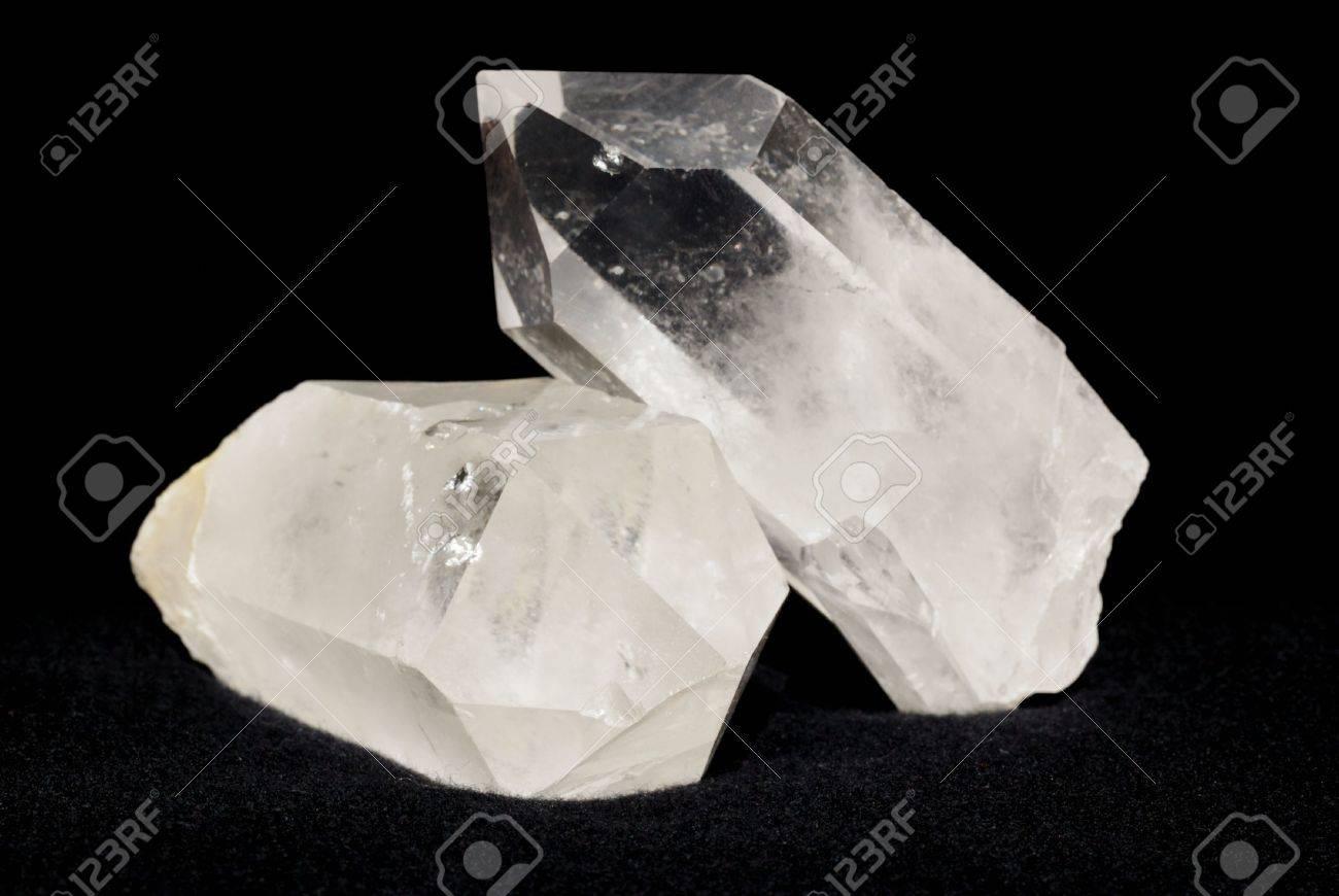 Quartz crystals laid on black textile. Quartz is used in esoteric and also in alternative medicine. Stock Photo - 3680986