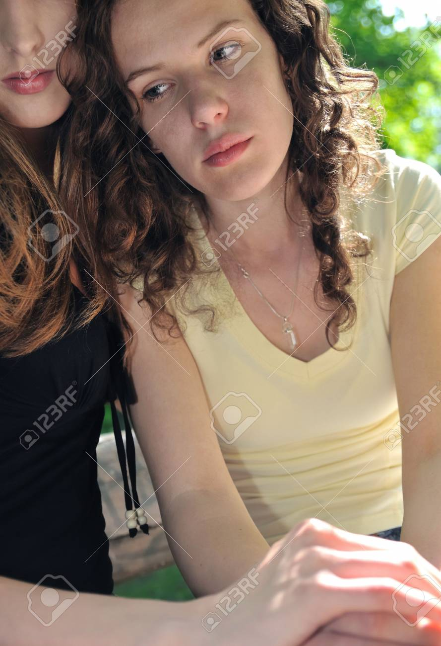 Friends - one teenage girl comforts and regrets other which has serious problem Stock Photo - 5404085