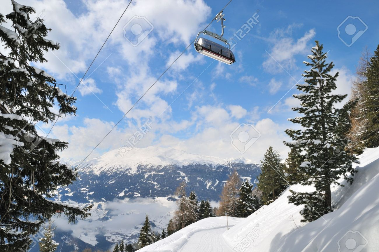 Empty Ski Lift In Beautiful Winter Snowy Mountain Landscape Resort Alps Stock Photo