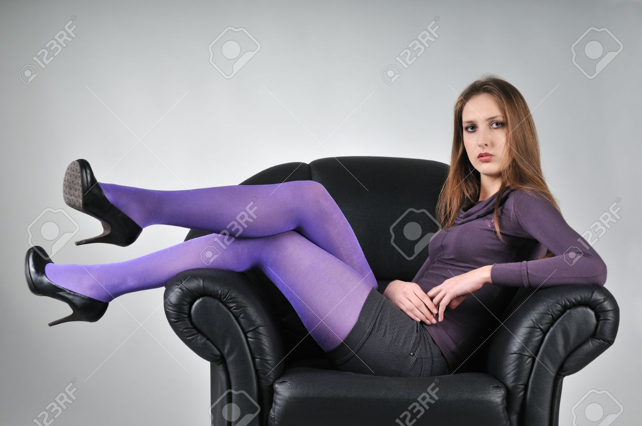 Portrait Of Young Woman With Violet Pantyhose Sitting In Big ...