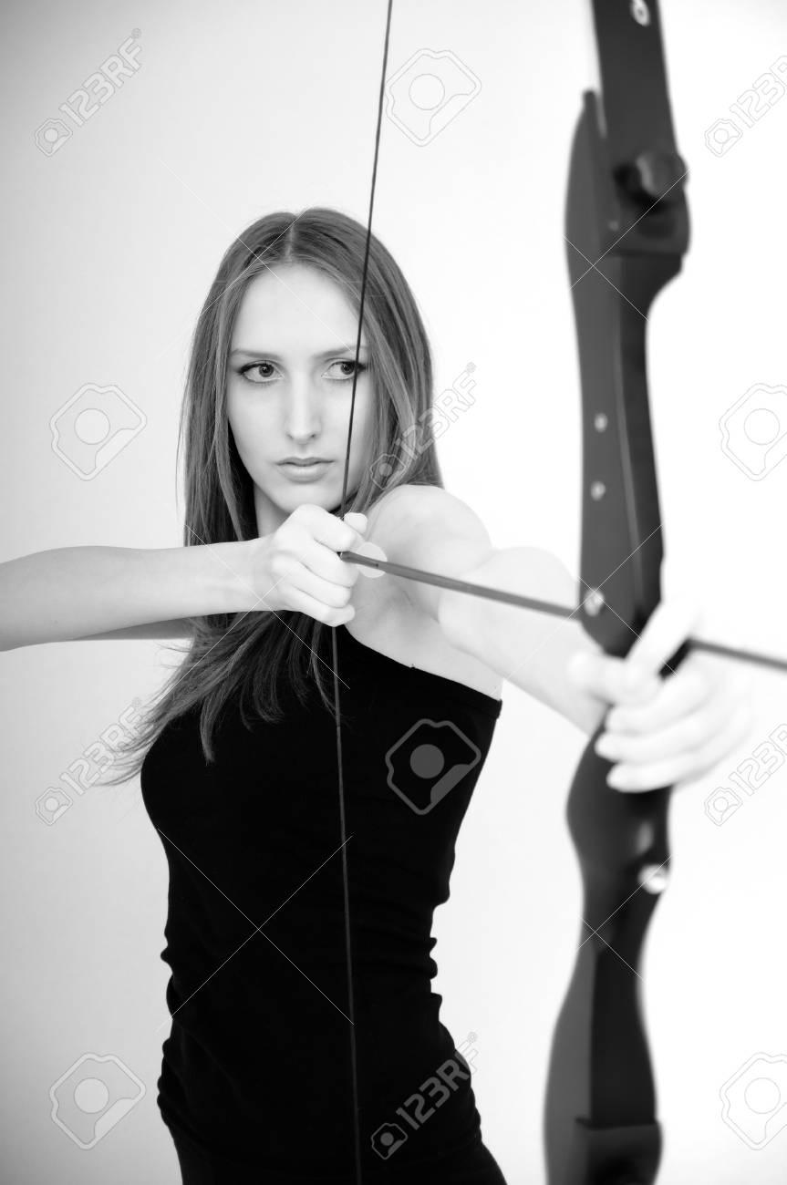 Beautiful woman aiming with bow - studio shot Stock Photo - 6958909