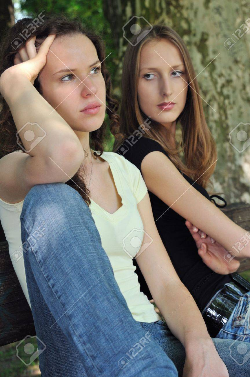 Friends outdoors series - two teenage girls are angry due to ther conflict Stock Photo - 6959062