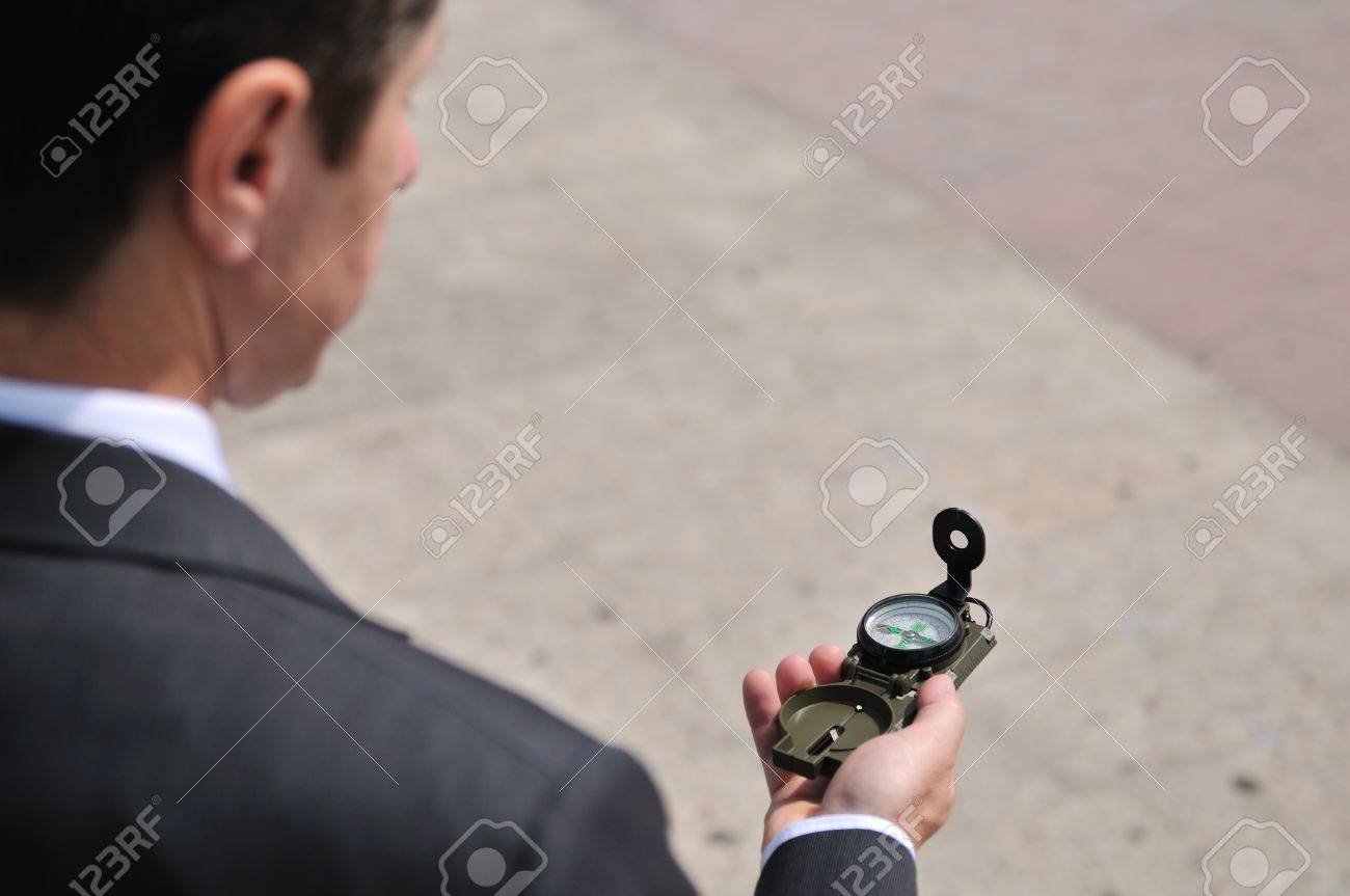 Senior people series - portrait of mature business man looking at compass with copy space Stock Photo - 7807662