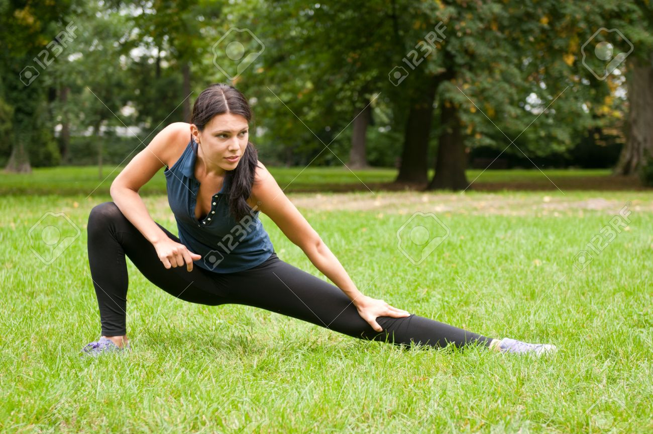 Woman performs stretching before sport in park Stock Photo - 7807760