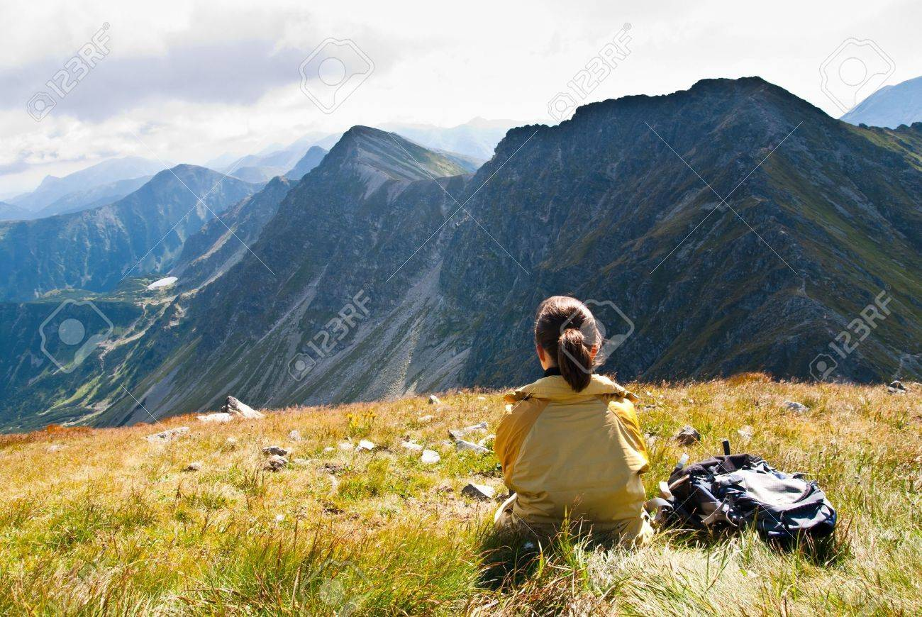Young person relaxes on hiking in mountains (East Tatras, Slovakia, central Europe) Stock Photo - 8957672