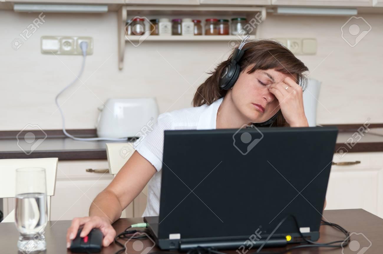 Business woman with headache Stock Photo - 10711397