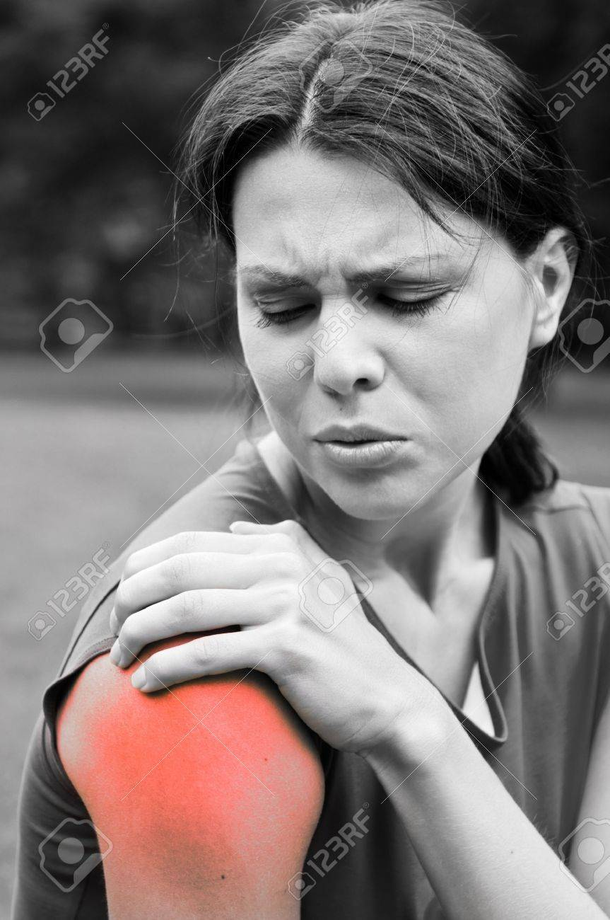 Shoulder injury - sportswoman in pain Stock Photo - 12082879