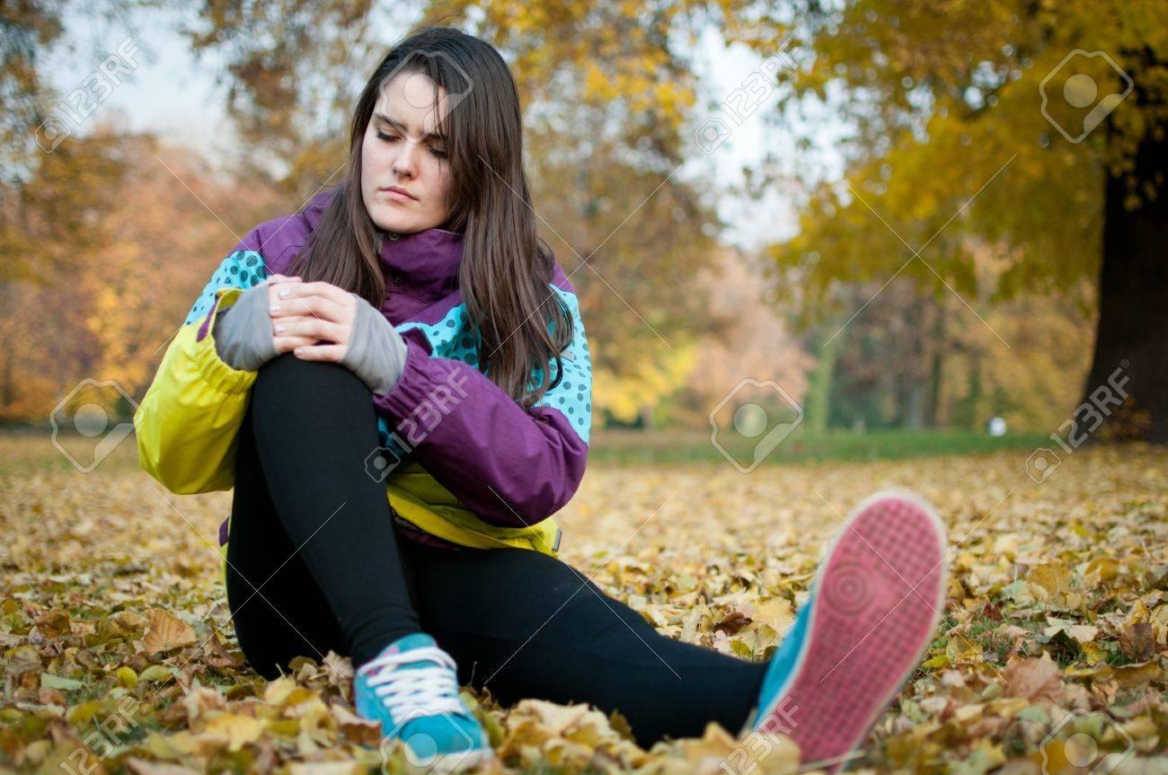 Knee injury - woman sitting in pain Stock Photo - 12082855