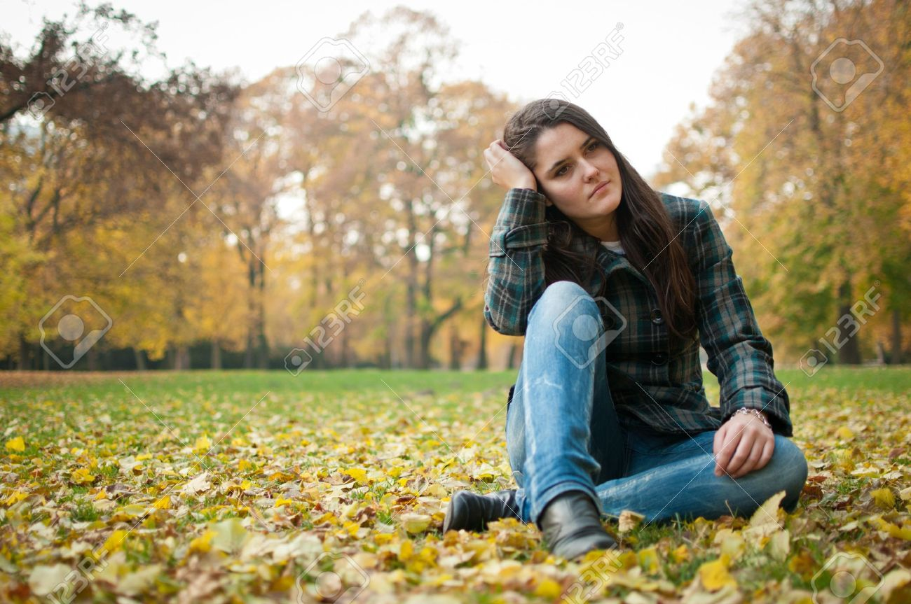 Young woman in depression outdoor Stock Photo - 12082858