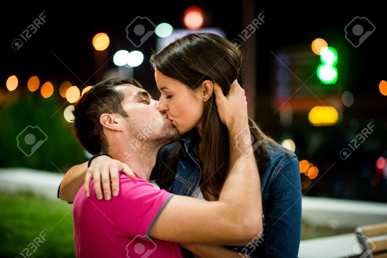 Couple kissing at night stock photo 37504935