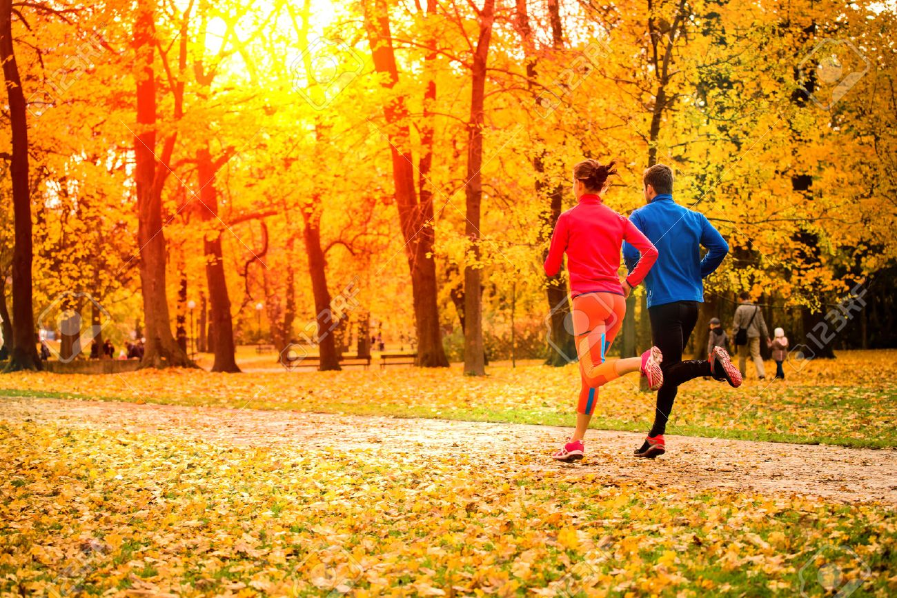 Young Couple Running Together In Park - Fall Nature Stock Photo ...