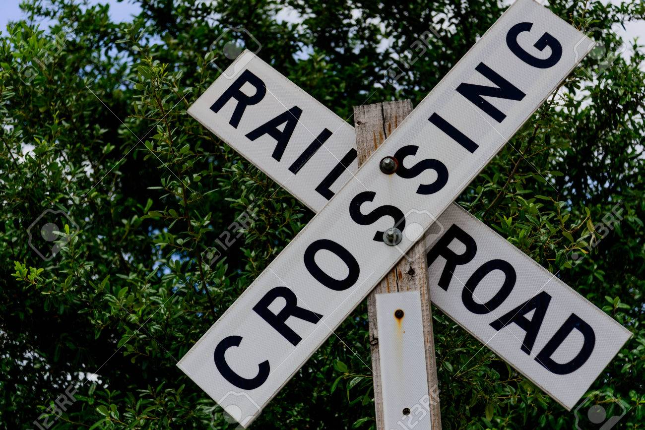 railroad crossing sign on a wood post