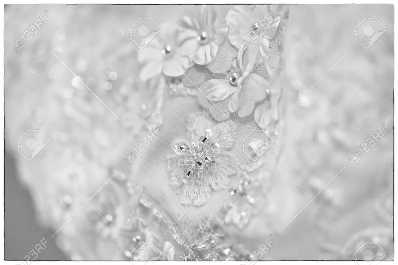 A Black And White Macro Photo Of A Detailed White Wedding Dress