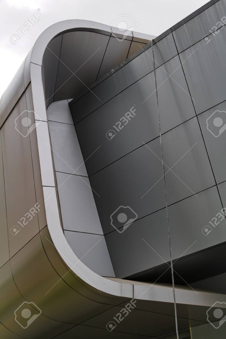 Folded metal cladded detail of modern building  Cladding is made