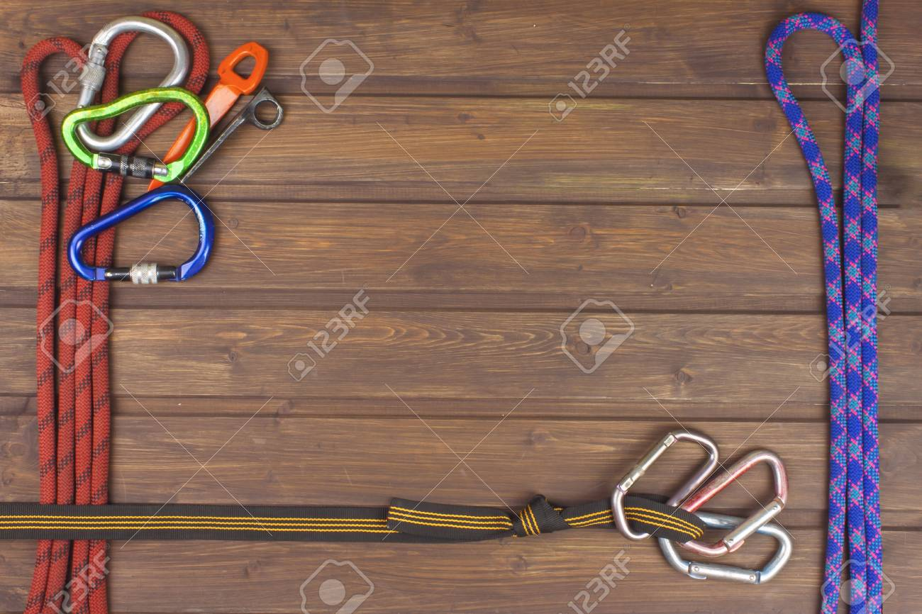 Used Climbing Gear On Wooden Background Advertising Boards Of