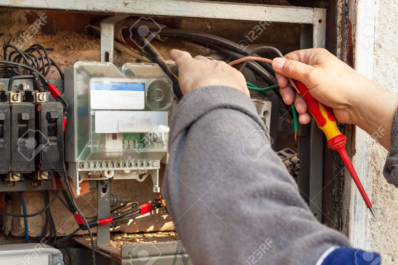 Repair Of Old Electrical Switchgear. An Electrician Replaces.. Stock ...