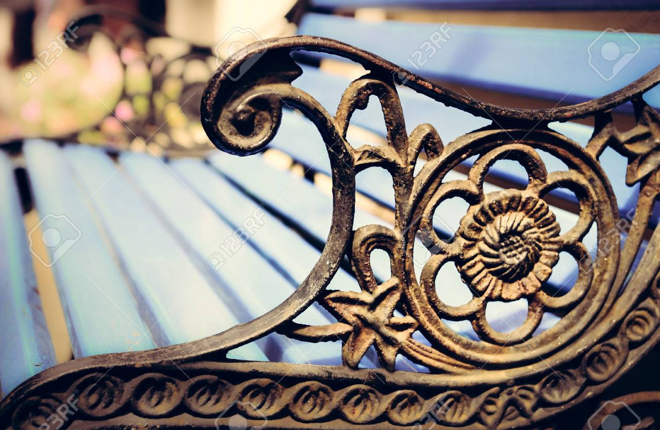 Detail Of Old Park Bench With Ornaments And Bokeh Background