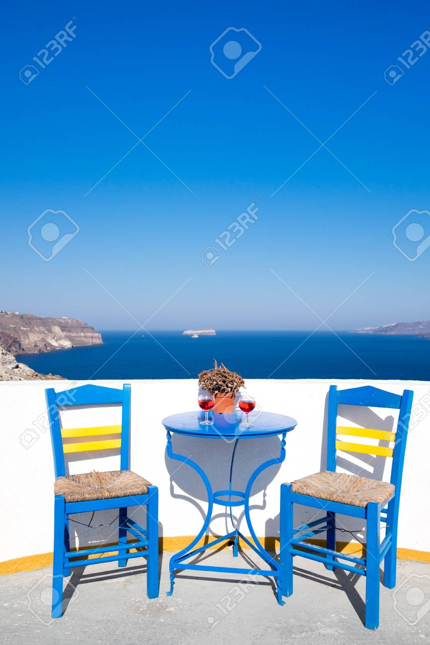Marvelous Blue Chairs And Table On A Mediterranean Balcony With Nice View To The Sea,  Santorini