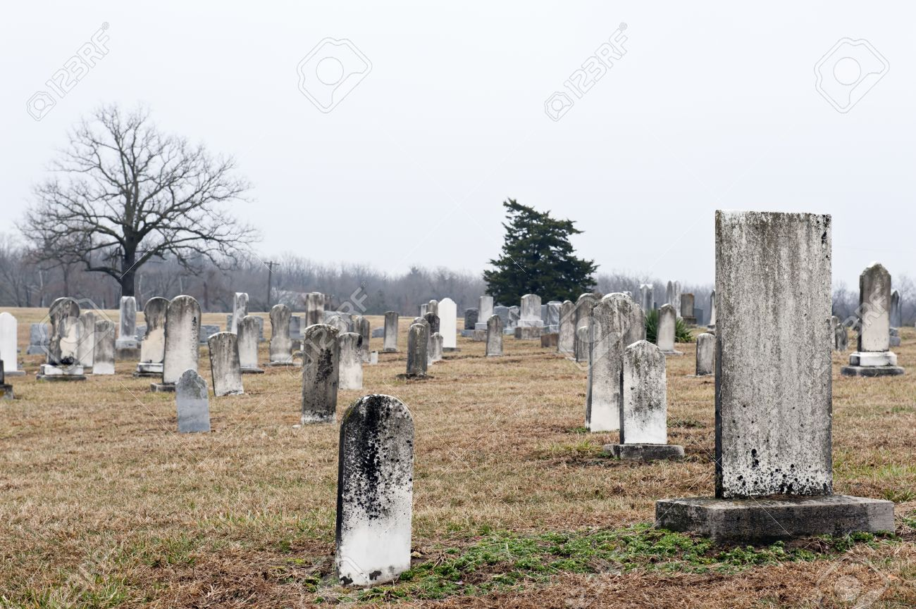 Very old tombstones in a country church graveyard, selective focus on large tombstone near camera Stock Photo - 9090468