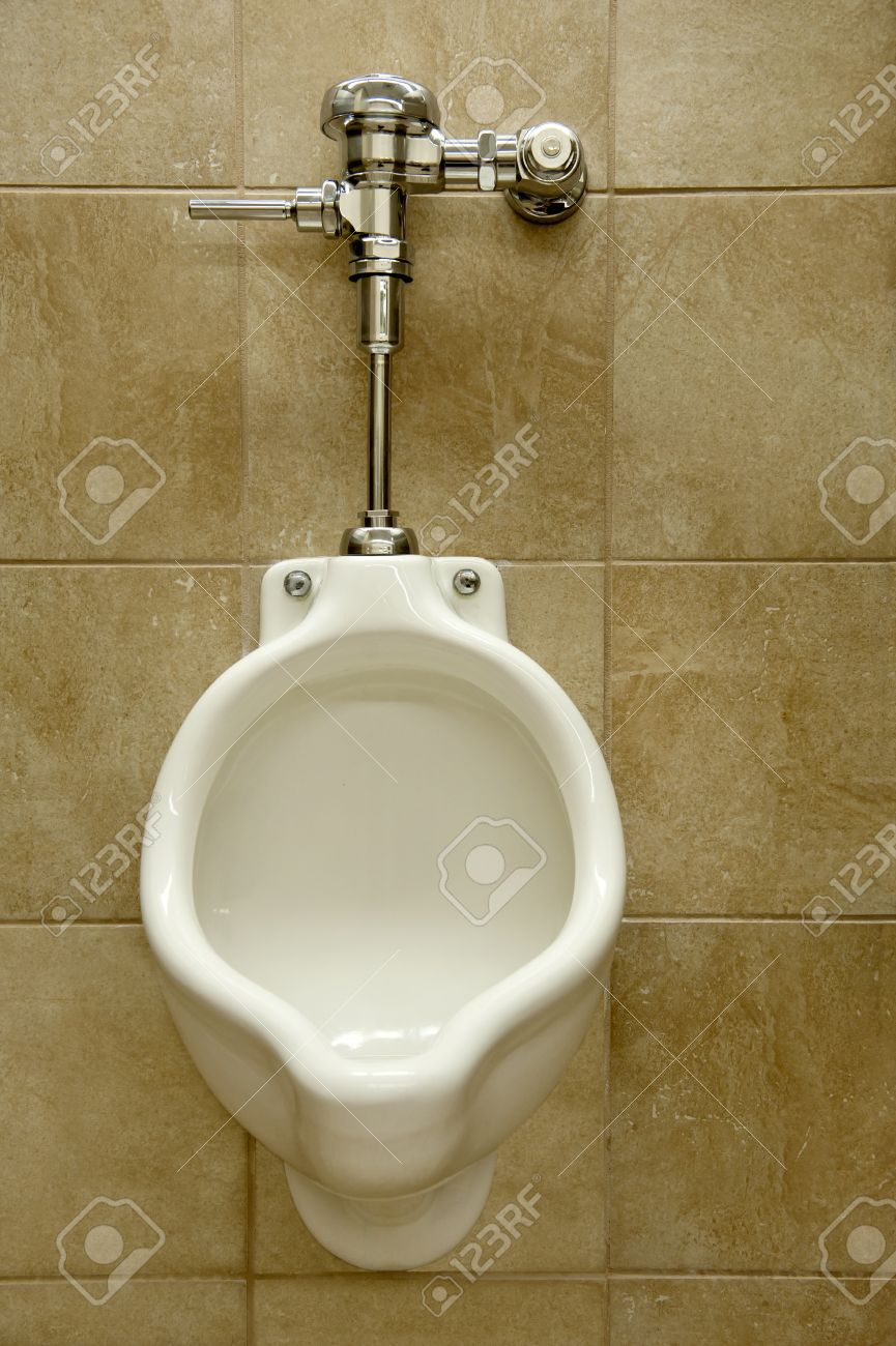 urinal on a marble tiled wall in a men Stock Photo - 10680279