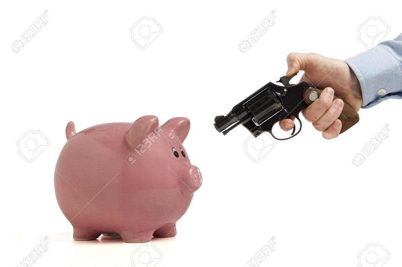 Close-up of a piggy bank being robbed by an armed man, isolated on white Stock Photo - 12530863