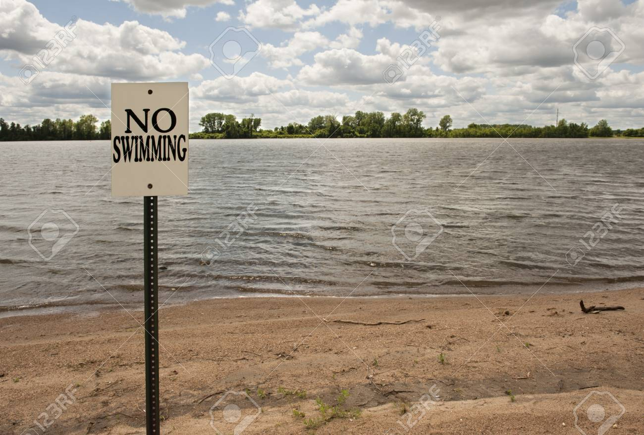 No swimming sign posted on a lake shore Stock Photo - 13579044
