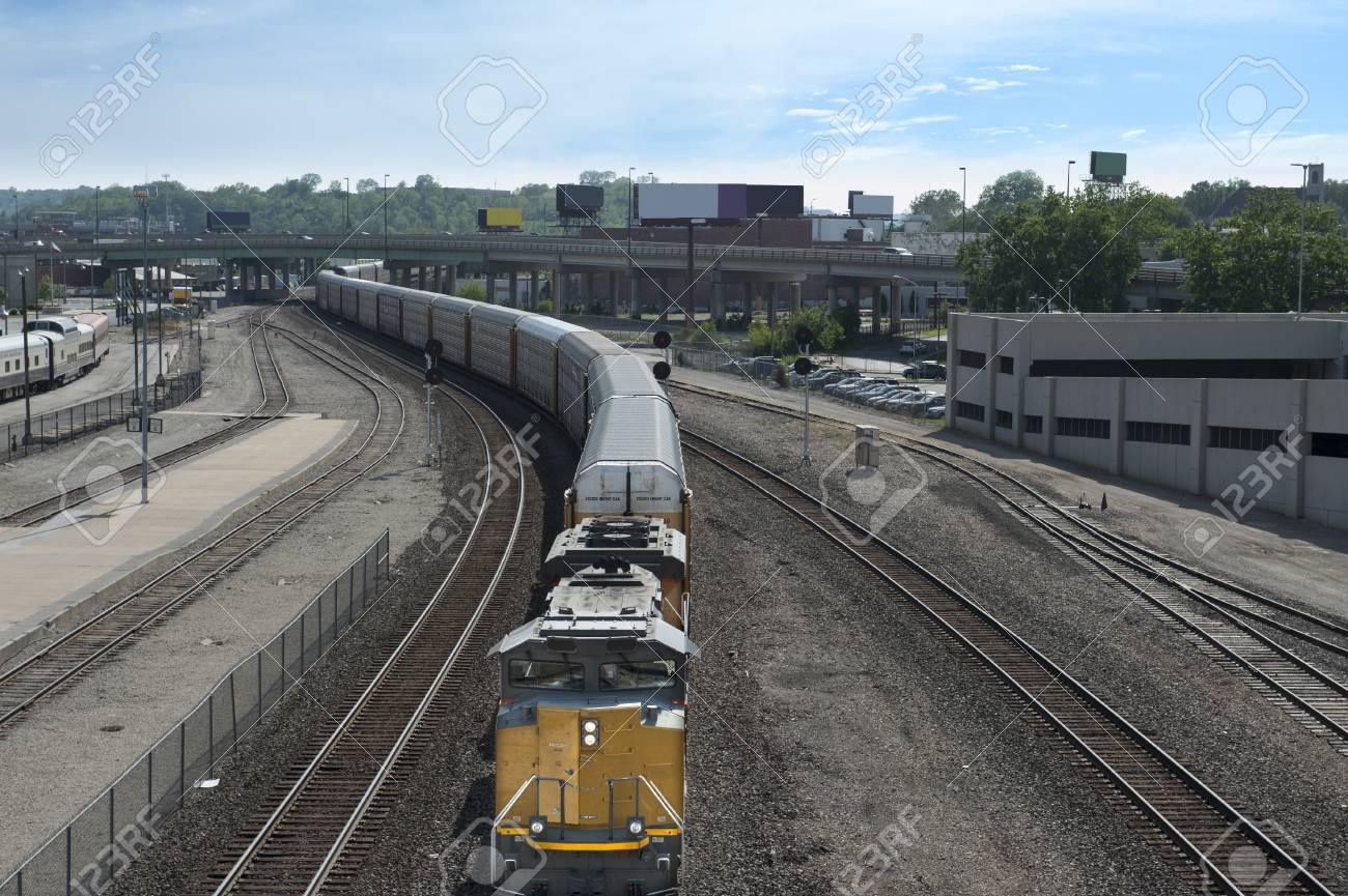 A frieght train approaching the camera in a winding urban stretch Stock Photo - 23283932