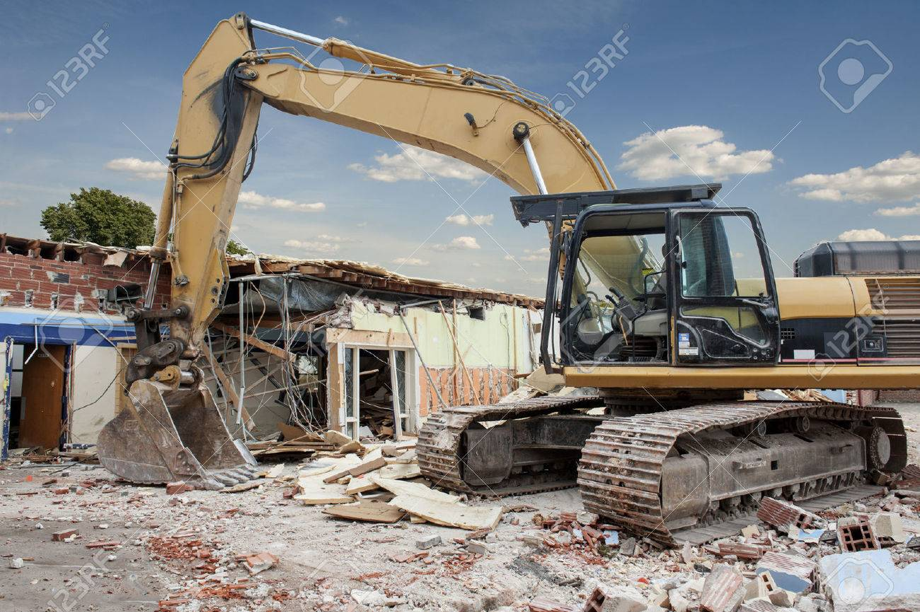 A large backhoe demolishes an old building Stock Photo - 23832367