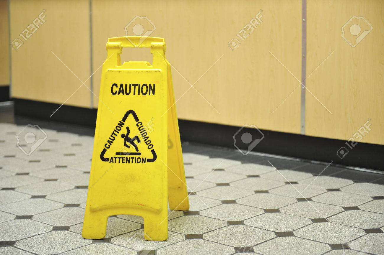 Slippery tile floor columbialabelsfo a yellow caution sign warning of slippery wet floors sits on stock dailygadgetfo Gallery
