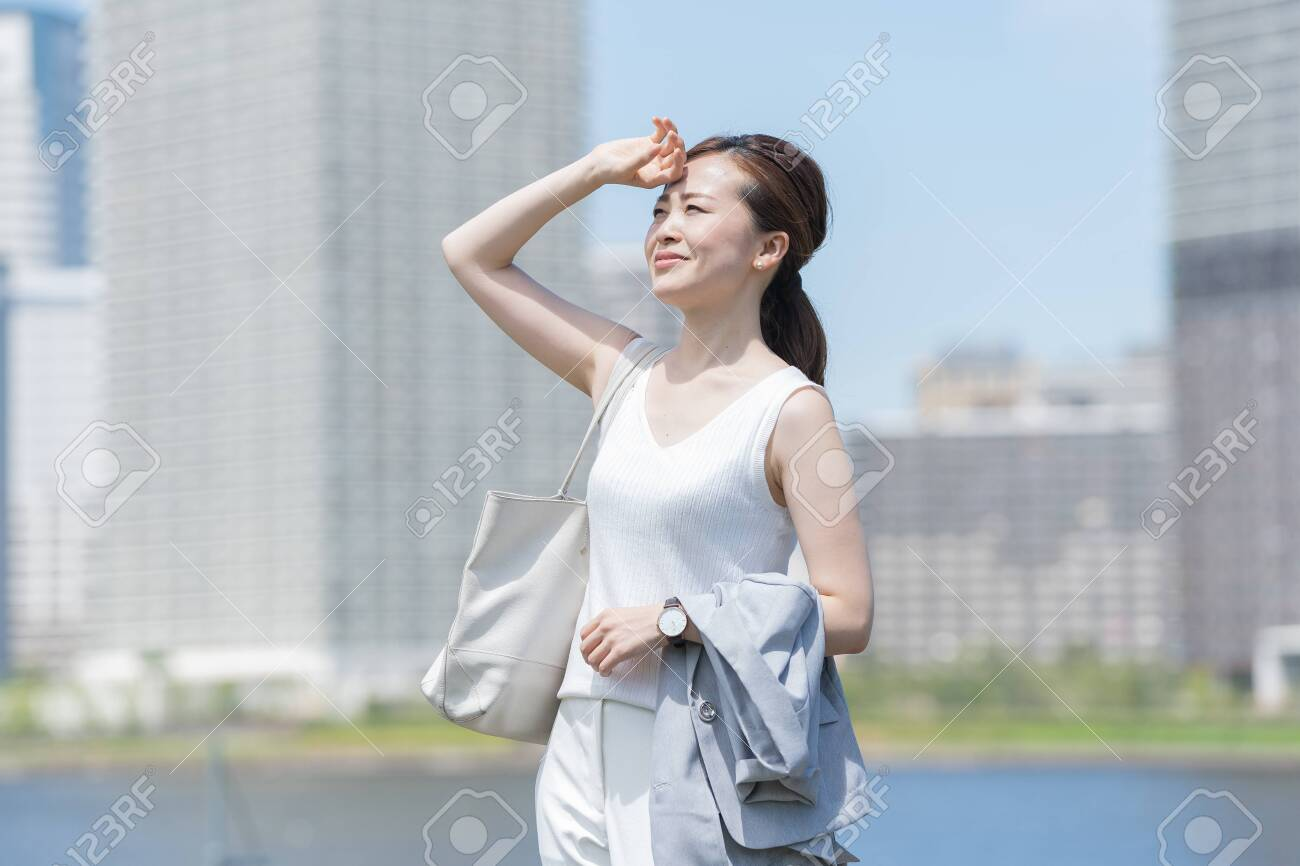 Businesswoman suffering from strong sunlight - 132158868