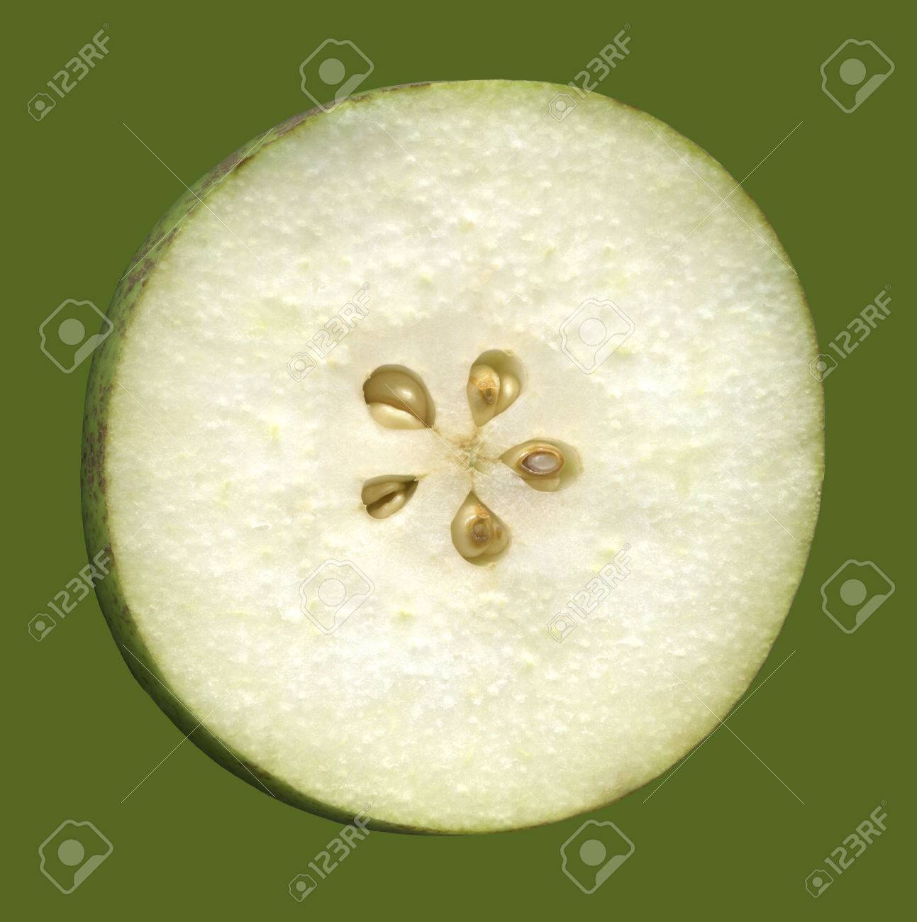 Cross section of fruit of pear, isolated on a green background. Building pear from the inside, where you can see her flesh and the core with the seeds. - 46572508