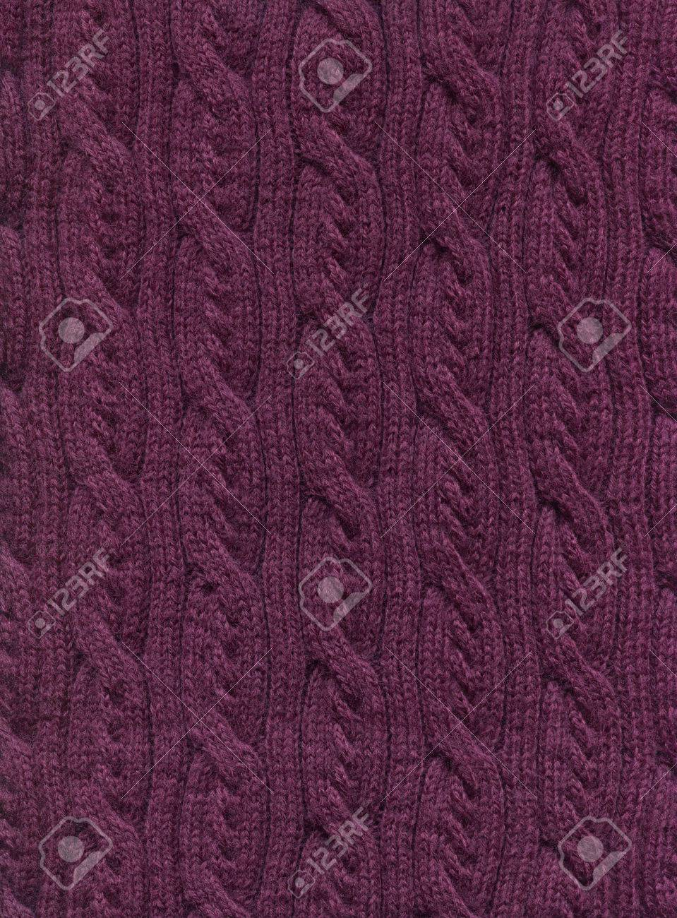 Knitted fabric with a pattern of vertical braids.Decorative material, background, texture, wallpaper - 69736110
