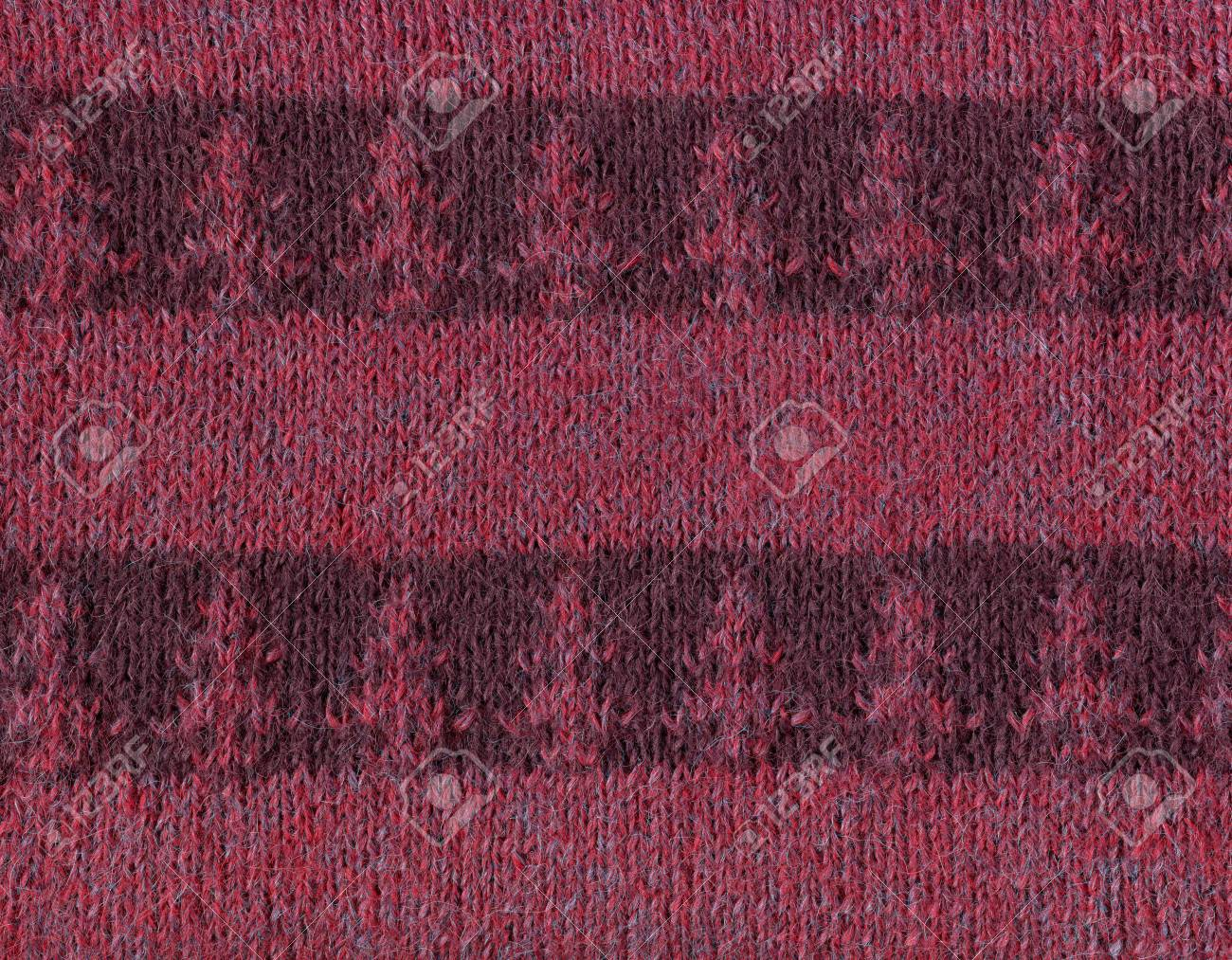 Striped knitted fabric with a pattern of fir trees.Decorative material, background, texture, wallpaper - 69666414