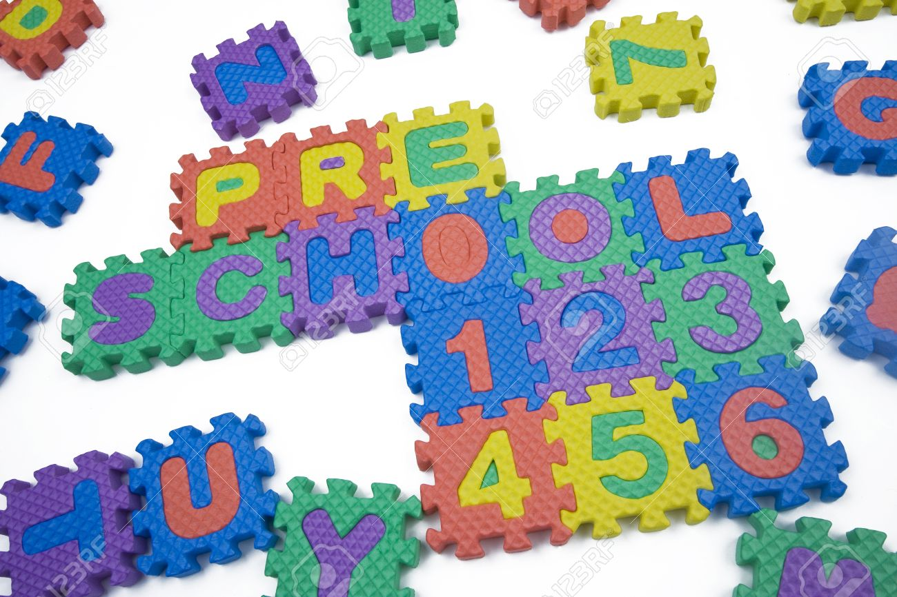 preschool and numbers written in foam letters on white background stock photo 8775139