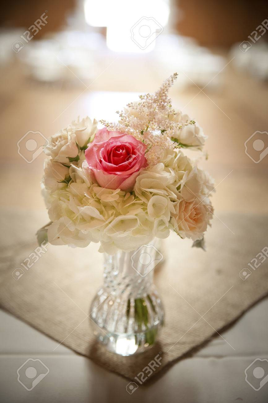Flower table decorations for weddings - Wedding Flowers On Venue Table Centerpiece With Pink Roses And White Flowers In Glass Vase