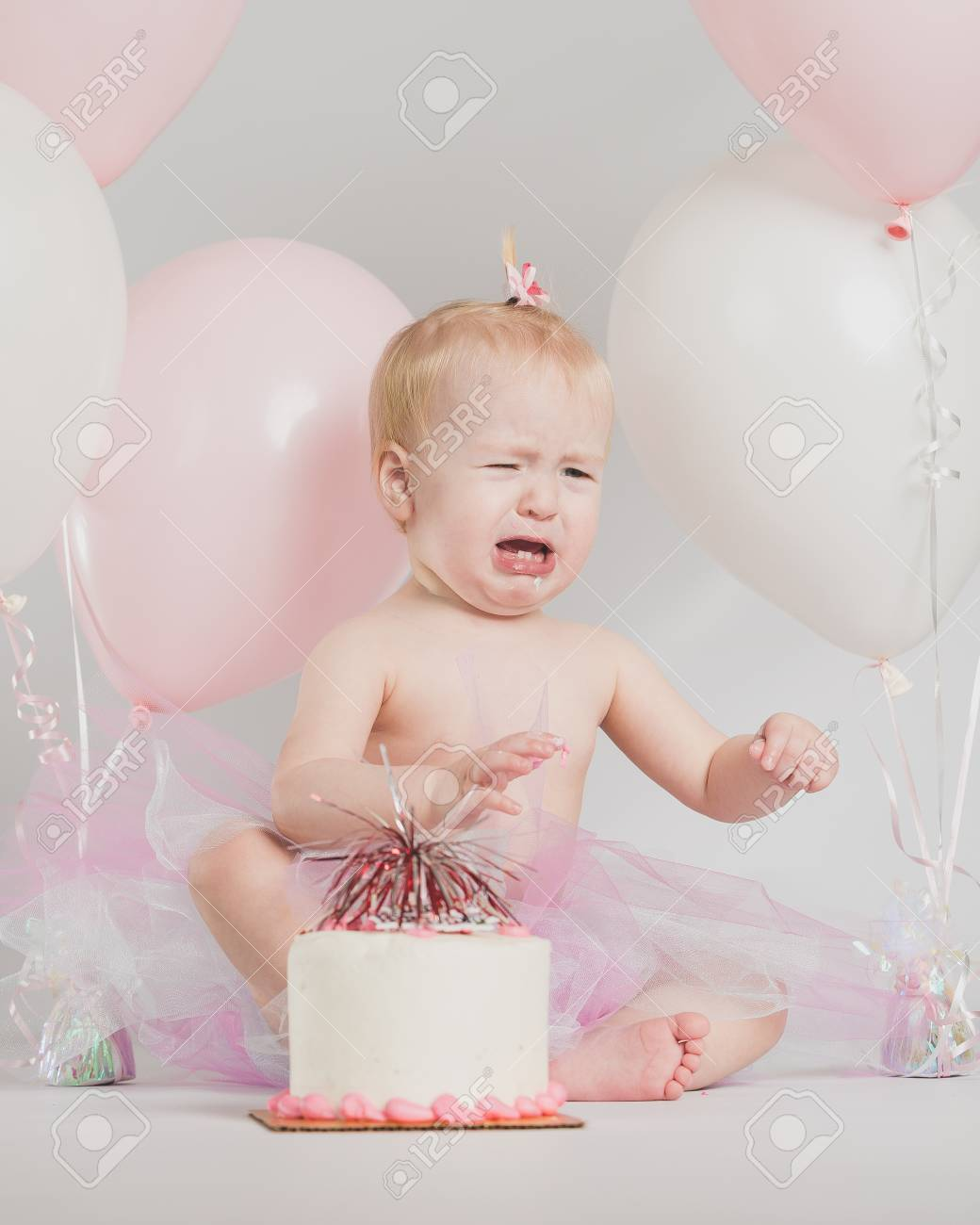 One Year Old Girl Birthday Portraits With Smash Cake Stock Photo