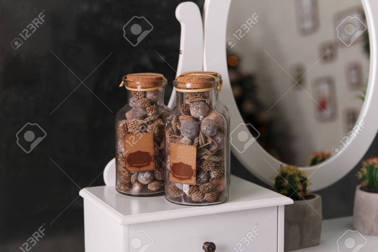 Three Decorative Glass Jars With Dry Nuts And Dry Stalks Decorate