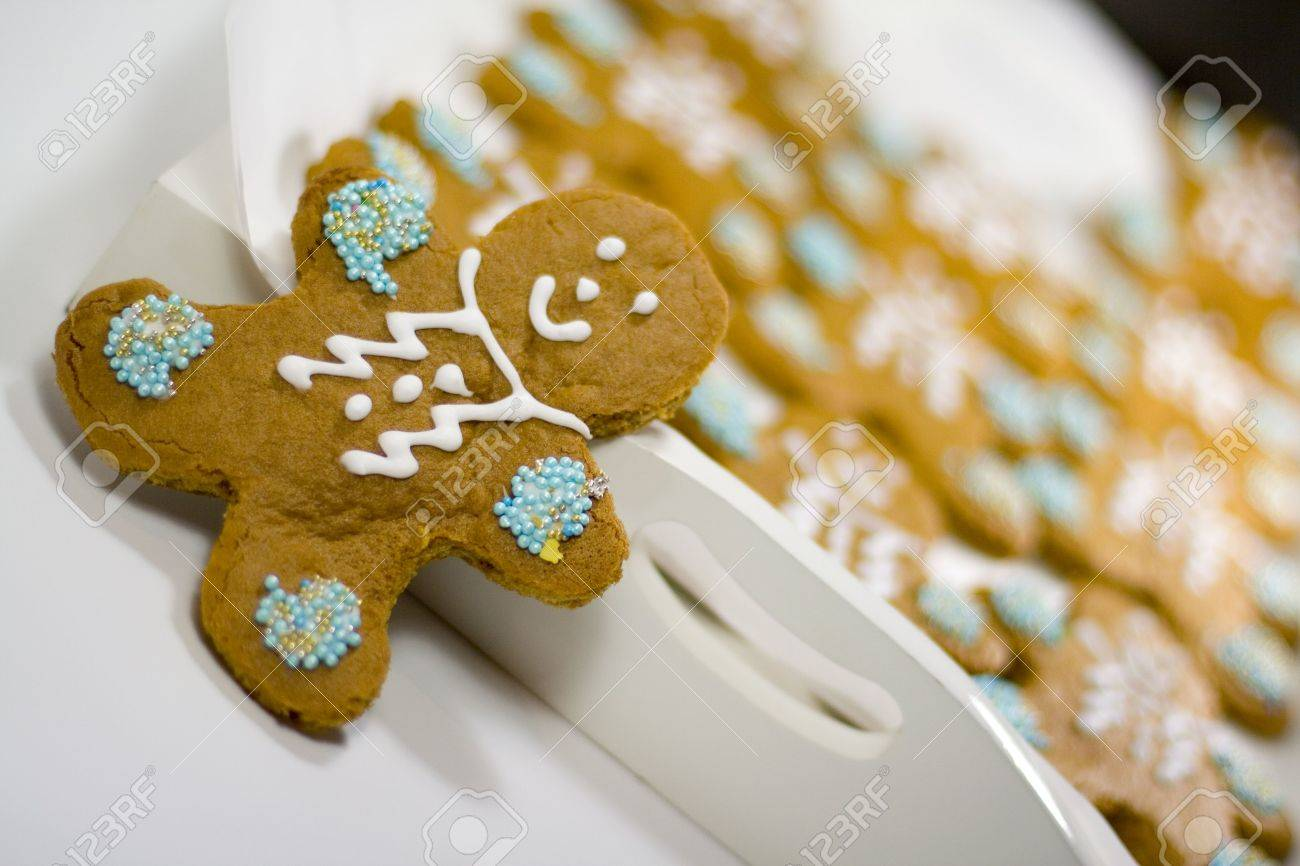 closeup of fresh baked cheerful gingerbread men cookies with decorations Stock Photo - 3467746