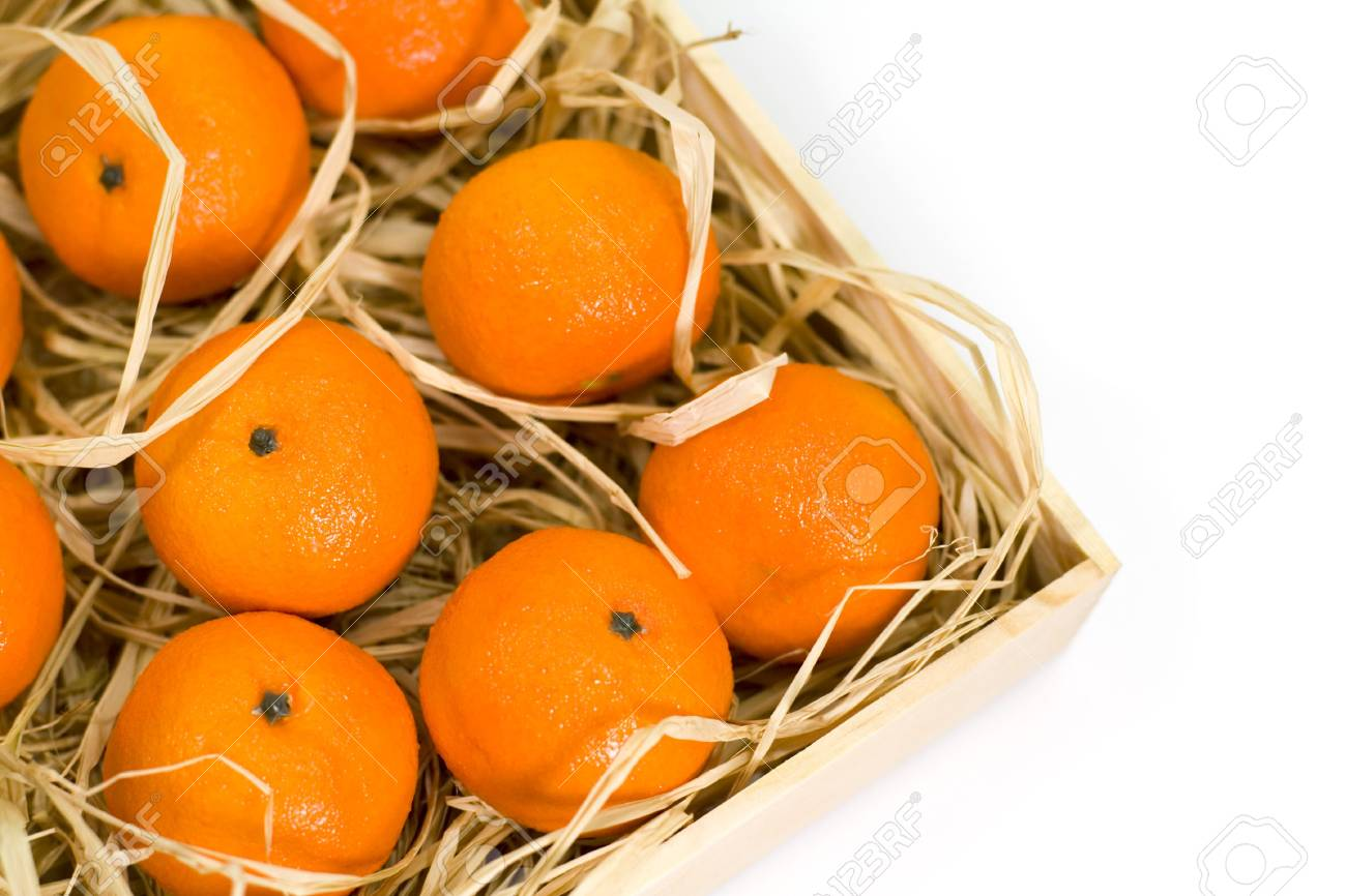 tangerines with straw in wooden box Stock Photo - 3725334