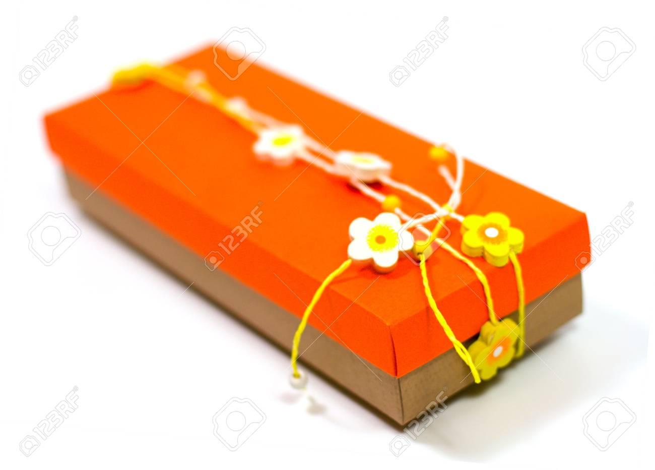 orange gift box with decoration isolated on white background Stock Photo - 3762232