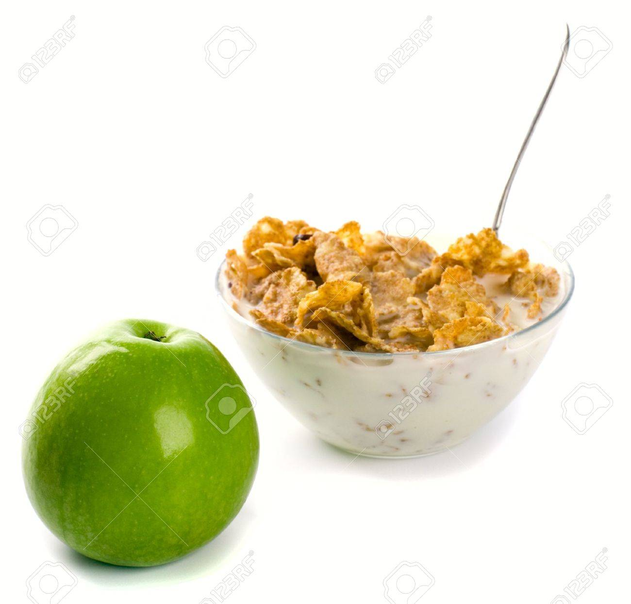 cornflakes with milk and green apple on white Stock Photo - 4286945