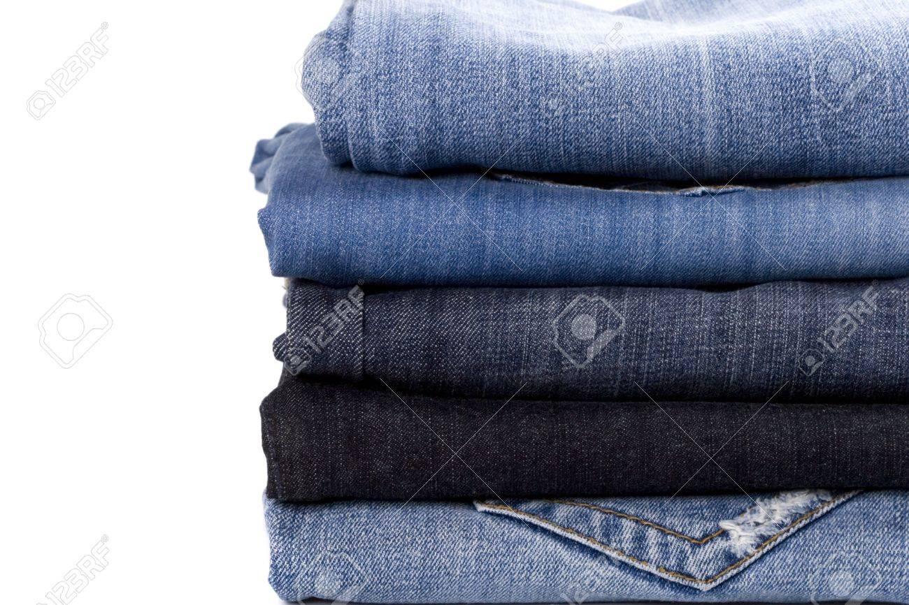 stack of blue jeans closeup on white background Stock Photo - 5936357