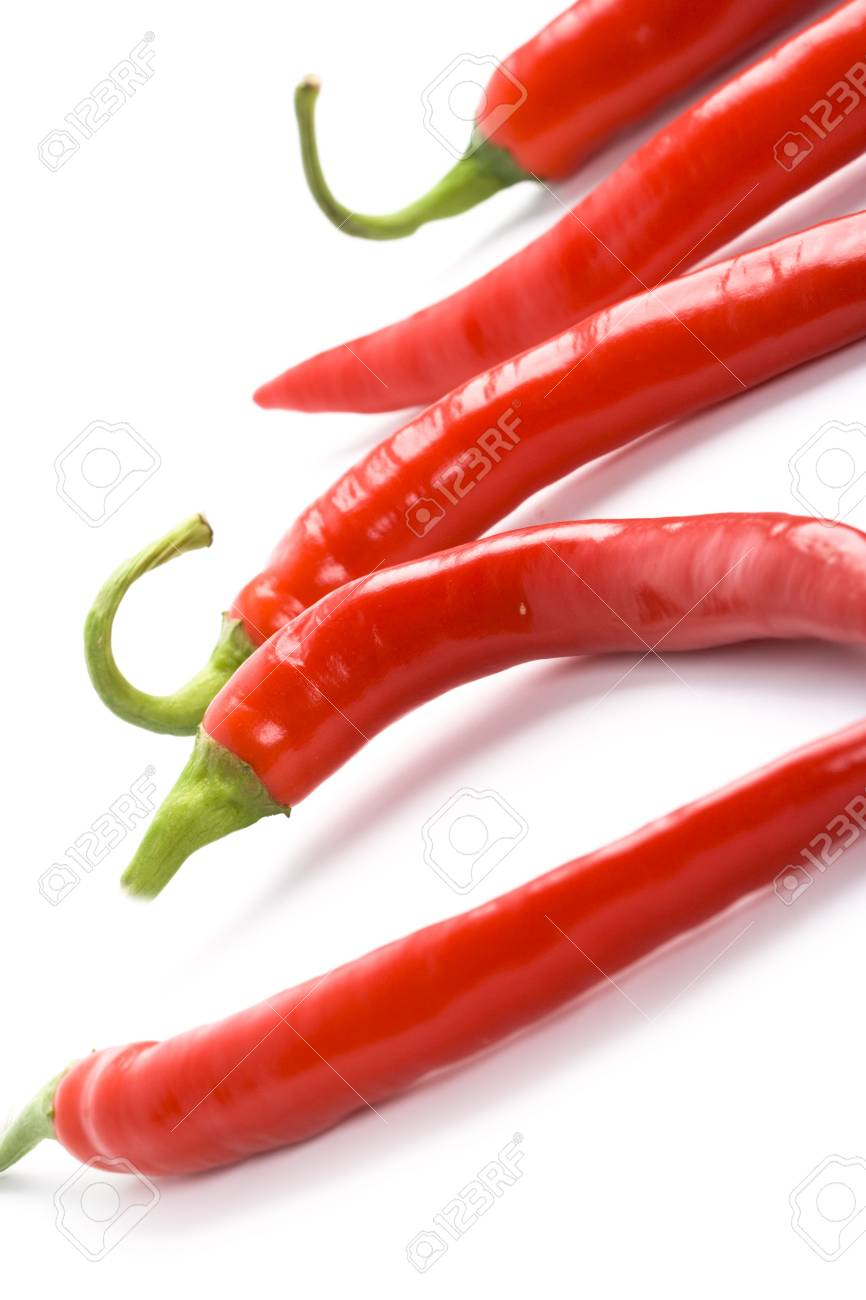 five red chilly peppers closeup on white background Stock Photo - 6031307