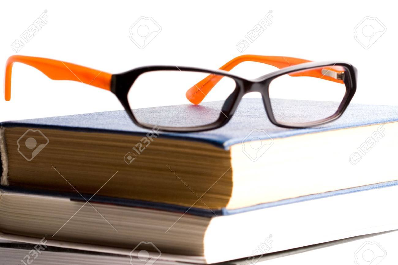books and glasses closeup on white background Stock Photo - 6136119